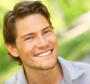 young man with a bright smile thanks to the teeth whitening spring lake trusts