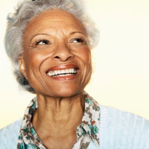 Senior woman with a beautiful, natural looking smile thanks to the dental implants spring lake residents prefer
