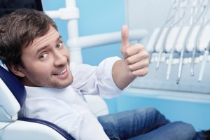 Happy patient visiting the dentist Spring Lake residents prefer