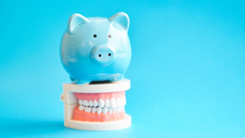 Piggy bank on model of teeth
