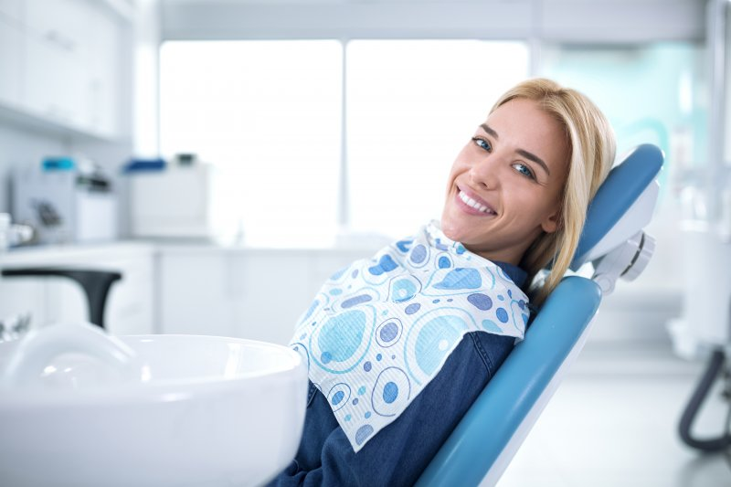 Woman smiling at routine dental appointment