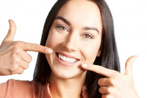Woman with beautiful smile from cosmetic dentist
